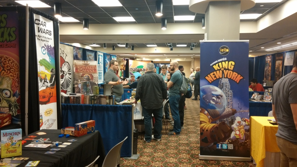 One of the many, many vendor aisles. There's a banner for King of New York, which is a successful follow-up to King of Tokyo.