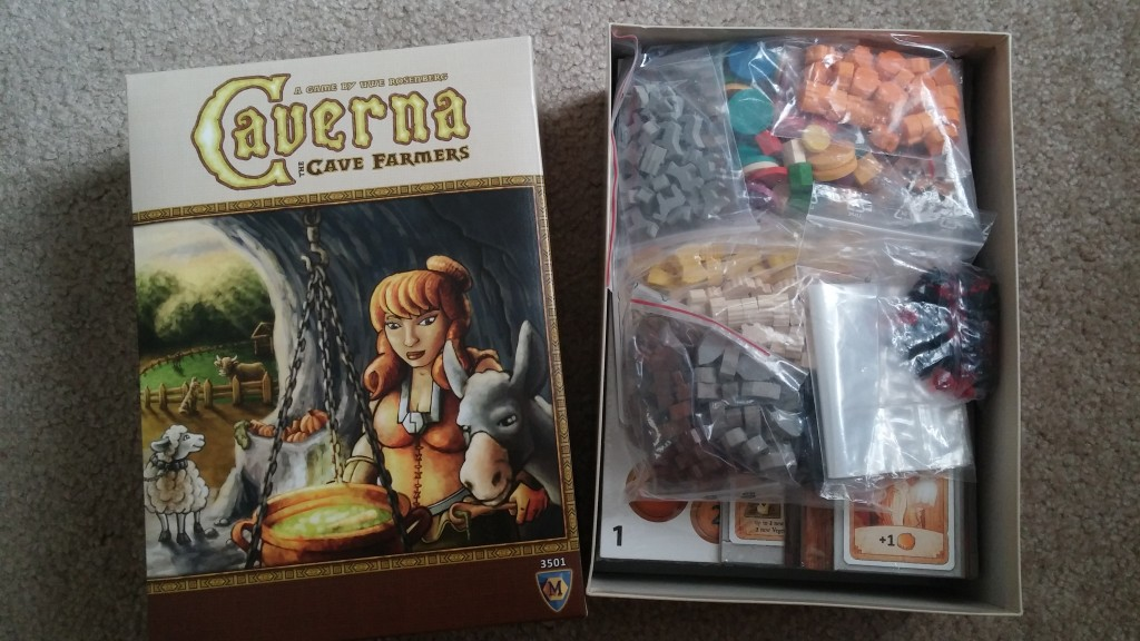 This is what it looks like when you open Caverna for the first time. Beneath the many bags of resources is 8 sheets of cardboard that require punching out as well as player boards.