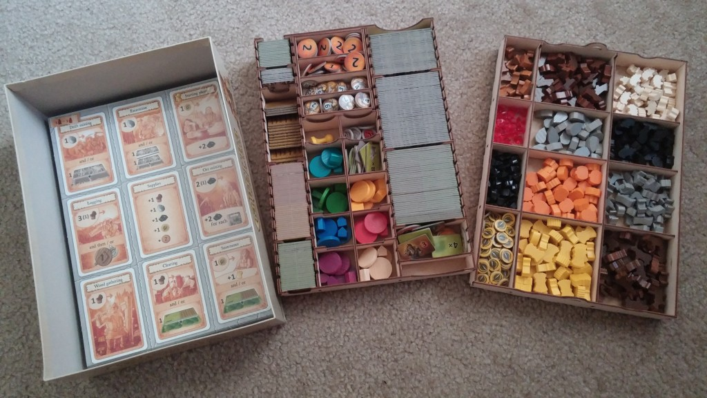 Look how organized everything is! The Broken Token organizer for Caverna is a must-have for the game. But don't forget to glue your organizer together.