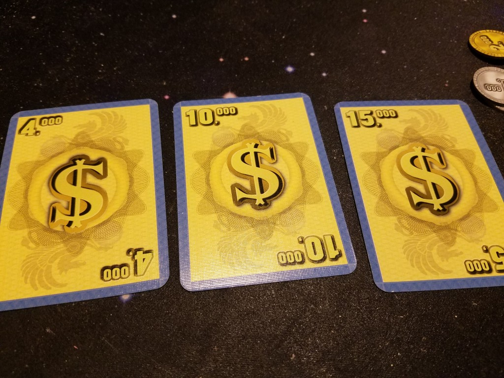In Phase 2, players sell their Property Cards for Currency Cards.