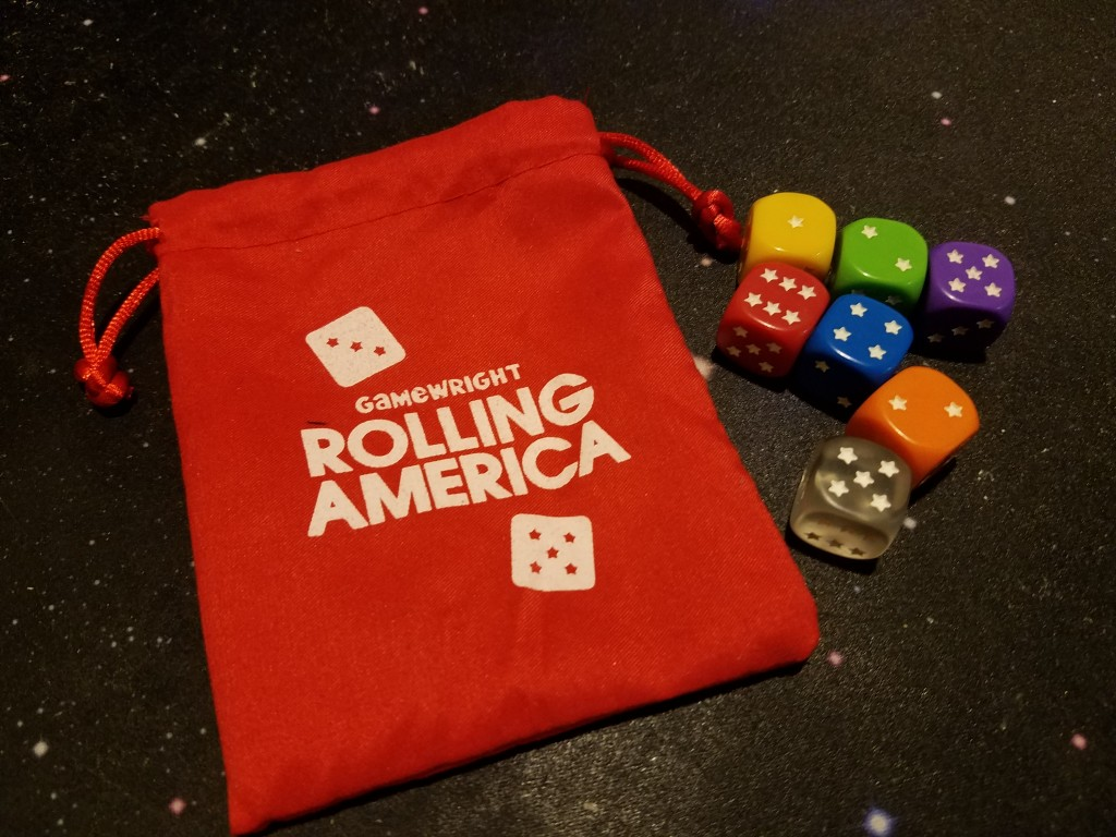The game comes with these dice and dice bag. Only 6 are used in each round.