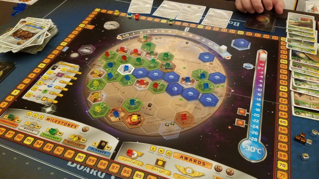 We are trying to make Mars inhabitable for humans. It played well with 4 people, not too much down time in between turns.